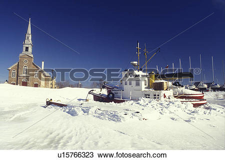 Stock Photo of Canada, Quebec, Boats in the frozen St. Lawrence.