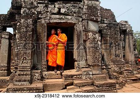 Stock Photo of Buddhist monks at Bayon temple, Angkor thom, UNESCO.