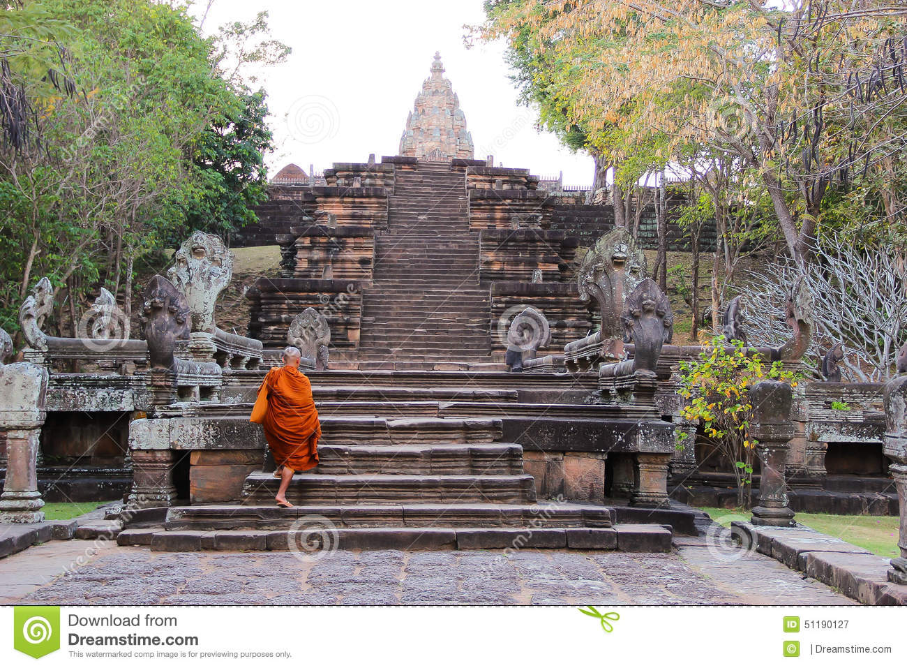 Monk Climbing Up Stairs At Pranom Rung Stone Clastle, Buriram.