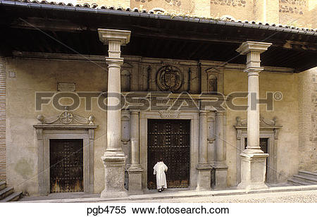 Stock Image of Spain. Toledo. Castile La Mancha. Monk entering.