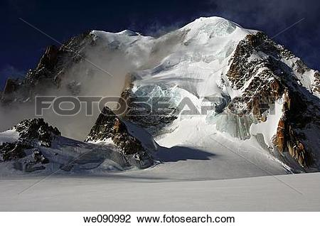Stock Photo of Morning mist at Mt Mont Blanc du Tacul near.