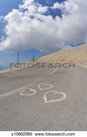 Stock Image of Three hearts painted on road to Mont Ventoux.
