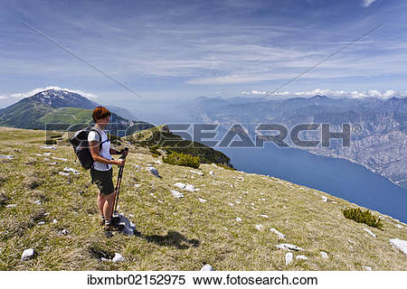 """Stock Image of """"Climber on Mount Altissimo above Nago, overlooking."""
