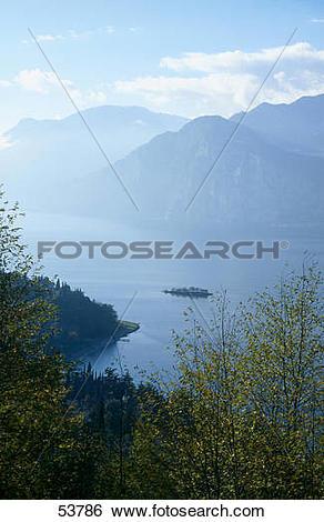 Stock Images of Mountains in fog at lakeside, Lake Garda, Monte.
