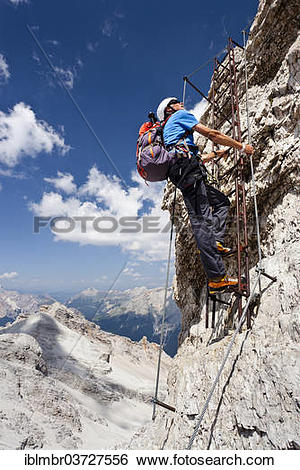 "Stock Images of ""Mountain climber ascending the Via Ferrata Ivano."