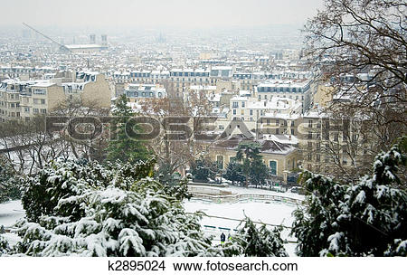 Stock Photo of Rare snowy day in Paris. Parisian roofs covered.