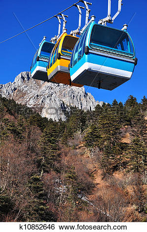 Stock Images of Group of cable car cabins in blue moon valley.