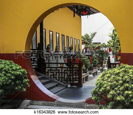 Stock Images of A typical circular Chinese moon gate, leading to a.
