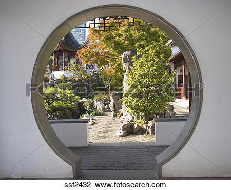Stock Photo of Moon gate looks into formal Chinese Courtyard and.