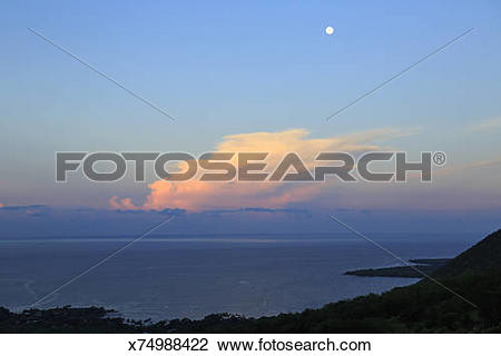 Stock Photo of Pink cloud at moonset and sunrise in Hawaii.