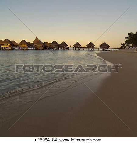 Stock Photo of Bungalows over Water and Beach at Moorea in Tahiti.