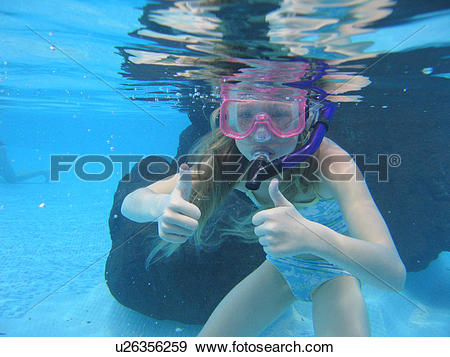 Stock Photograph of Underwater view of a young girl (12.