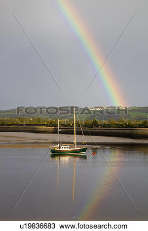 Stock Photo of North Wales, Conwy, Conwy, Rainbow over moored boat.