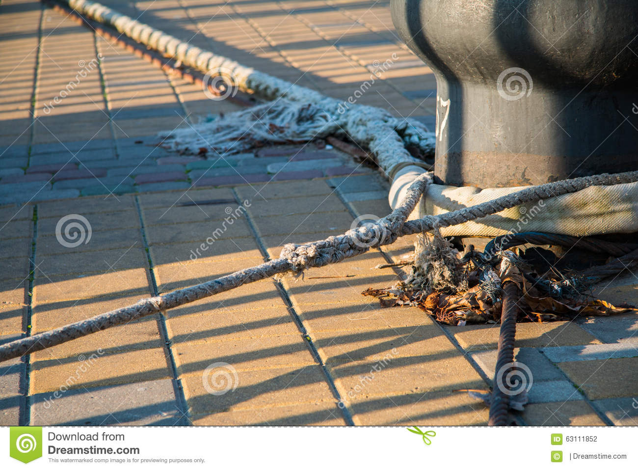 Mooring Lines Secure A Tugboat To A Quay Stock Photo.