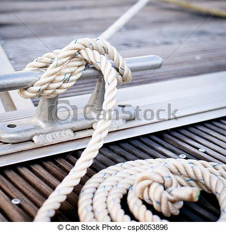 Stock Image of White mooring rope on ship.