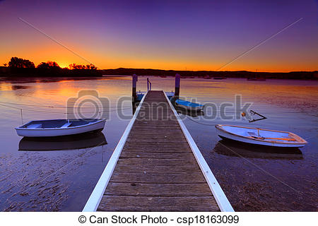 Stock Photographs of Sunset moorings and boat jetty in a little.