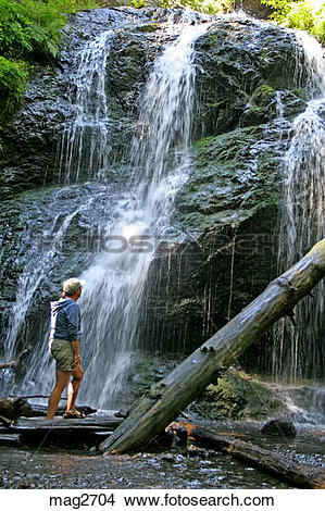 Stock Photo of Woman at waterfall in Moran State Park Orcas Island.