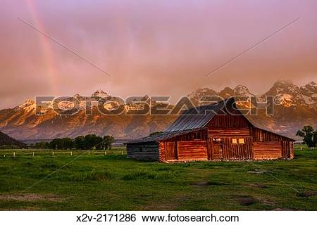 Stock Images of Moulton Barn at sunrise with rainbow on Mormon Row.