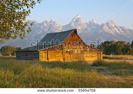 Sunrise On A Mormon Row Barn Under The Grand Tetons, Wyoming.