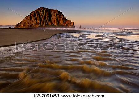 Stock Photo of Sunrise light on Morro Rock over Little Morro Creek.