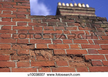 Picture of Serious decay of mortar joints and crumbling brick.