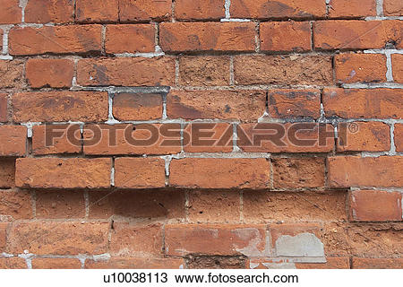 Stock Photo of Serious decay of mortar joints and crumbling brick.