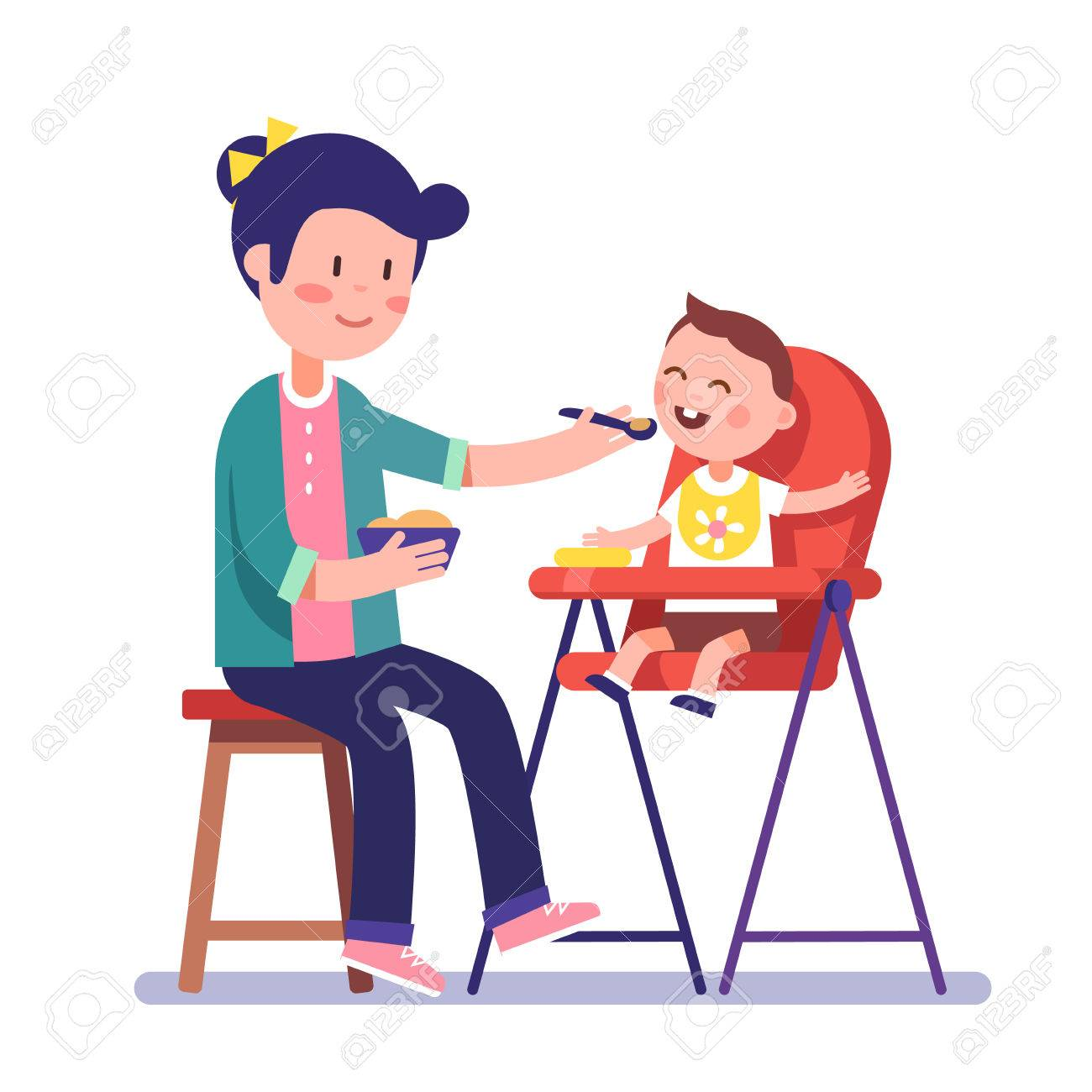 Mother feeding her baby child sitting on kids eating chair. Holding...