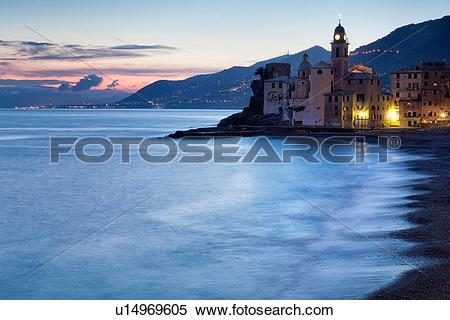 Stock Image of Camogli: beach and sea with motion blur, church.