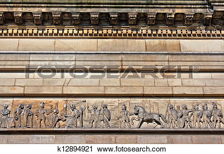 Stock Photography of Intricate mouldings on old sandstone building.