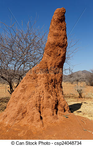 Stock Photos of Huge red termite mound in Africa.