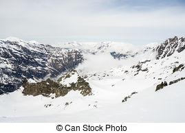 Stock Photographs of Panoramic view on ski resort in spring. Mount.