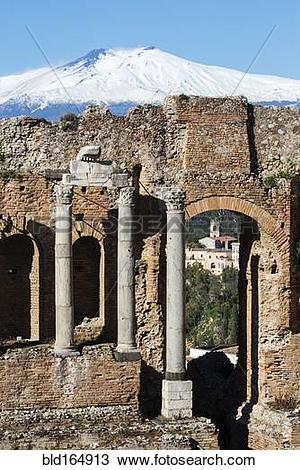 Stock Photo of Mount Etna over Greek Theater ruins, Taormina.