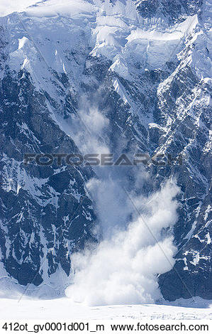 Stock Photo of Snow tumbles down an avalanche chute on Mount.