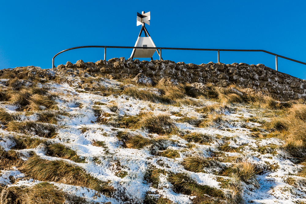 SNOWING ON TE MATA PEAK — Simon Cartwright.