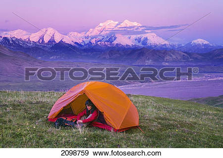 Stock Photograph of Backpackers Camp On Tundra In Tent With View.