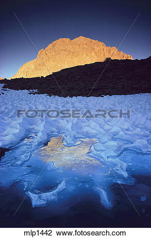 Stock Photo of Late summer snow under Mount Williamson, High.