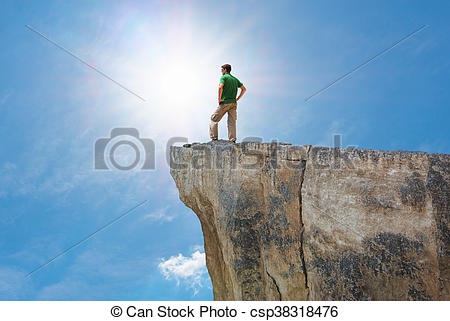 Picture of Man on the mountain edge. Conceptual scene. csp38318476.