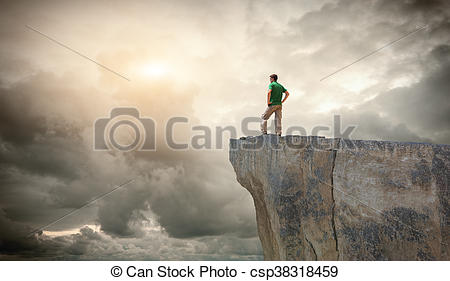 Stock Images of Man on the mountain edge. Conceptual scene.