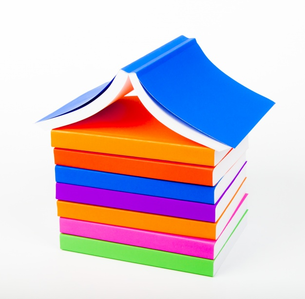 Mountain of books with white background Photo.