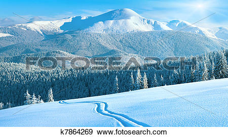 Stock Photograph of winter mountain panorama with ski track.