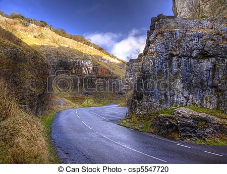 Stock Photography of Curvy road twists through mountain pass with.
