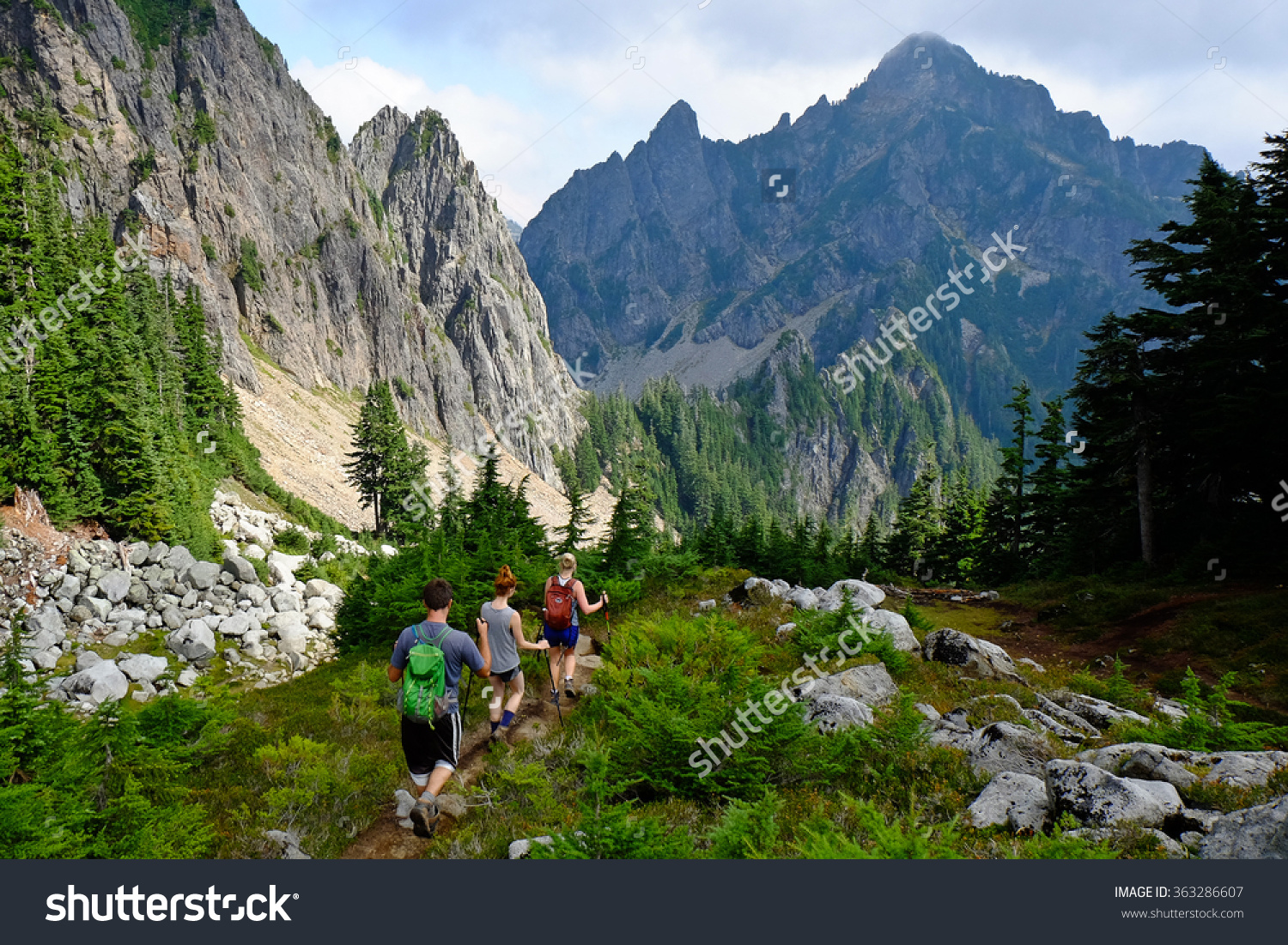 Three Hikers On Mountain Trail Cascade Stock Photo 363286607.
