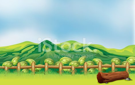 Mountain view across a wooden fence Clipart Image.