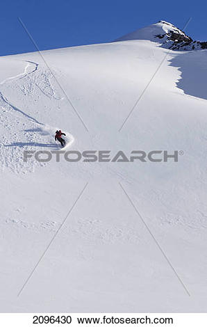 Stock Photography of Backcountry Snowboarder Carving Turns Down A.