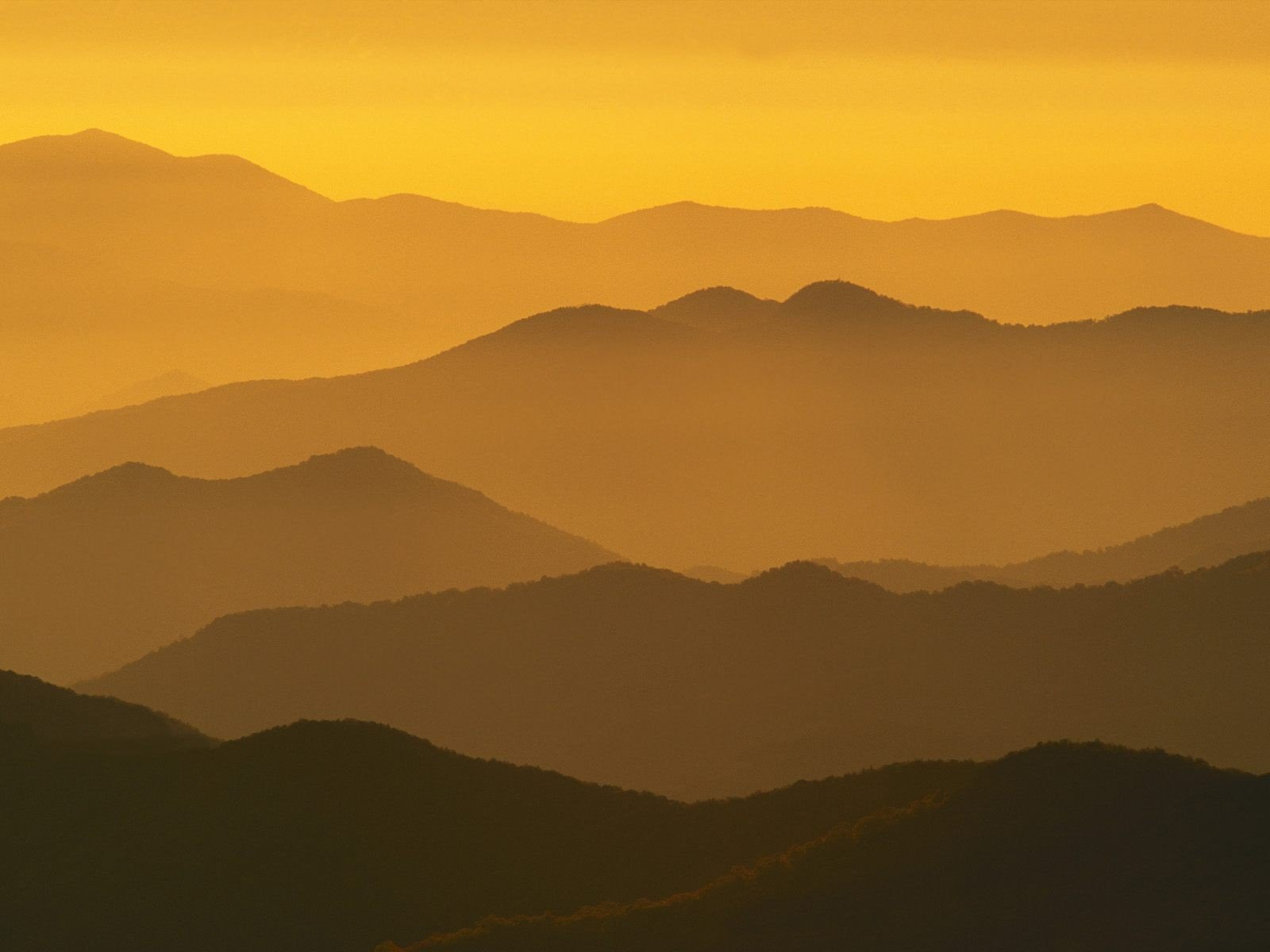 Mountains silhouettes mist sunlight dome North Carolina wallpaper.
