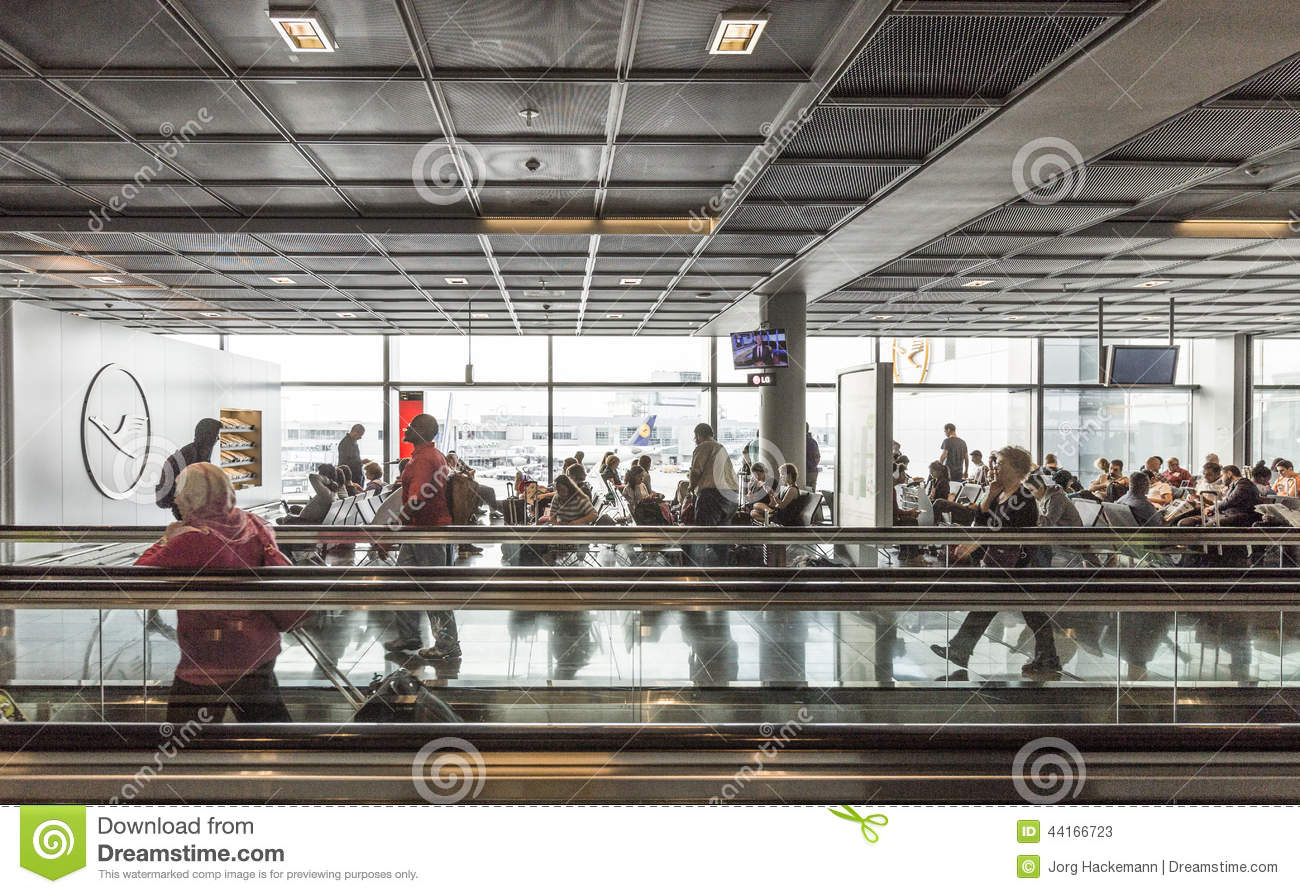 Passengers On A Moving Walkway And At A Gate In The Airport.
