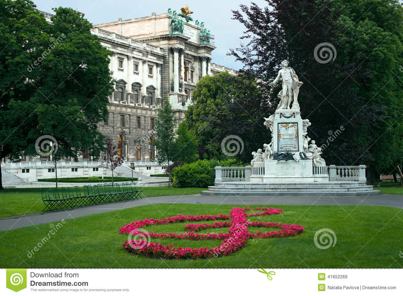 Statue Of Mozart And Hofburg Palace Stock Photo.