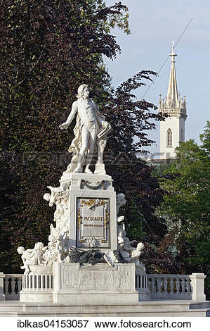 Picture of Mozart monument in Burggarten with Augustinian Church.