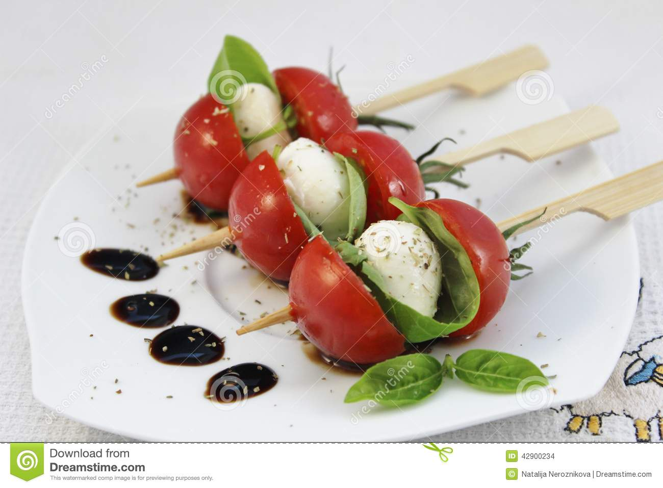 Appetizer With Baby Mozzarella And Cocktail Tomatoes On Skewers.
