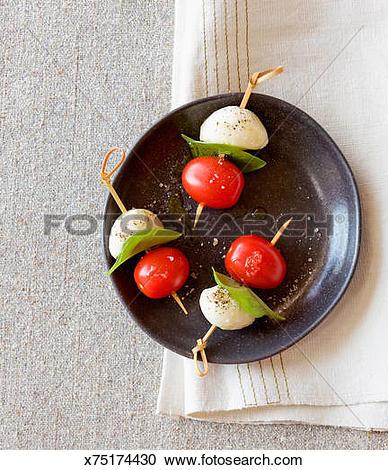 Stock Photography of Caprese Tomato Basil Mozzarella Skewer.